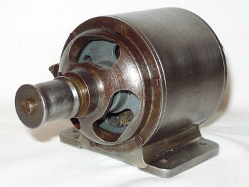 Dynamo for a miniature steam engine.