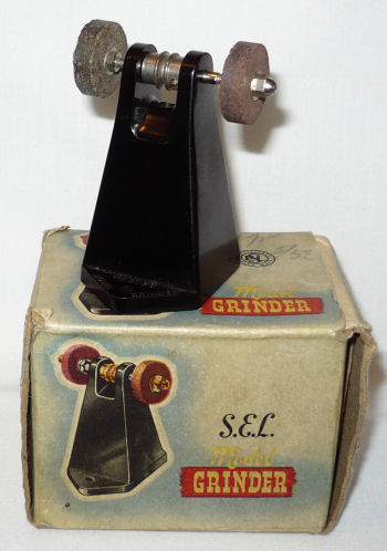 S.E.L. Grinder with box.