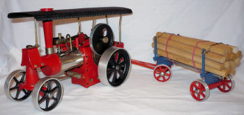 Wilesco Dampftraktor steam traction engine with Log trailer.